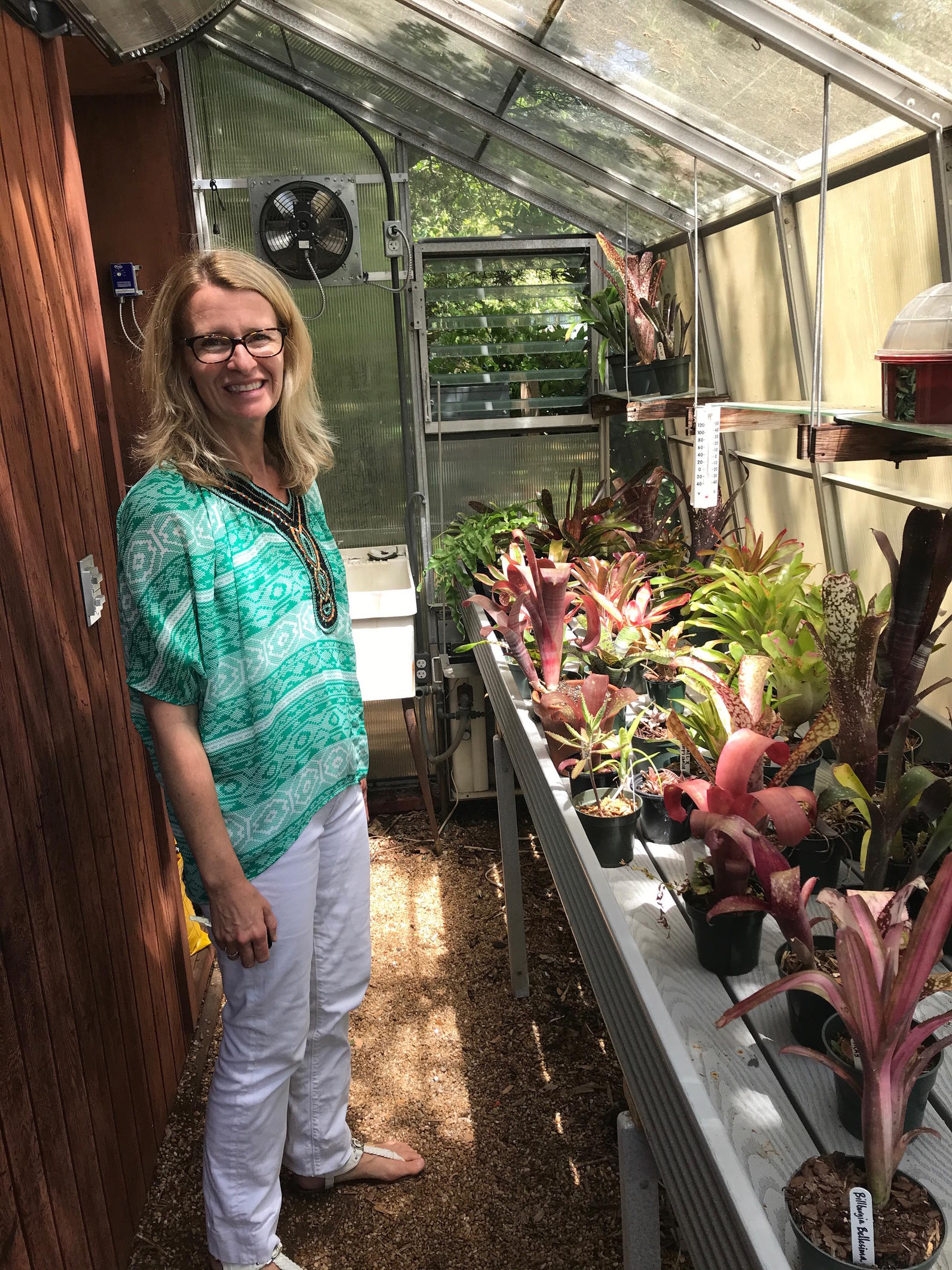 Allison Bowden shows off the greenhouse she and her students used to propagate succulents.